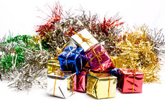 Christmas Decorations. Christmas tinsel and gift boxes Stock Photography