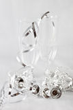 Christmas decorations. Two small champagne glasses surrounded by christmas decorations Royalty Free Stock Images