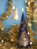 Christmas decorations. The christmas candle and chain Stock Images