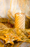 Christmas decorations. Christmas still-life with burning candle Stock Photo