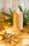 Christmas decorations. Christmas still-life with burning candle Stock Photos