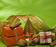 Christmas decorations. Ribbon, sweets and candy, candle and gift boxes in a setting Royalty Free Stock Photo