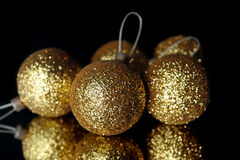 Christmas decorations. Gold christmas decorations balls on mirror Royalty Free Stock Photo
