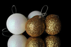 Christmas decorations. Gold and white christmas decorations balls on mirror Royalty Free Stock Photography