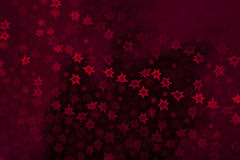 Christmas decorations. Red wrapping paper with stars Stock Photos