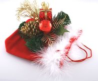 Christmas decorations. On red bag on white background Royalty Free Stock Image
