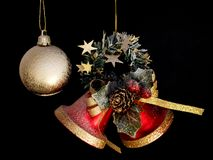 Christmas decorations. Bells and gold bauble Royalty Free Stock Photo