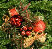 Christmas Decorations. Close-up of Christmas decorations on a background of artificial pine foliage Royalty Free Stock Photos