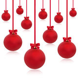 Christmas Decorations. Christmas baubles in red with ribbons and bows in abstract design, isolated over white background Royalty Free Stock Photos