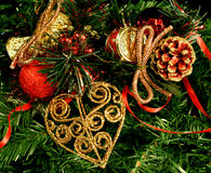 Christmas Decorations. Close-up of Christmas decorations on a background of artificial pine foliage Stock Image