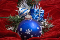 Christmas Decorations. Christmas ornaments on red velvet Stock Images