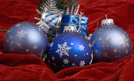 Christmas Decorations. Christmas ornaments on red velvet Royalty Free Stock Photo
