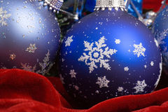 Christmas Decorations. Christmas ornaments on red velvet Royalty Free Stock Images