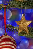 Christmas Decorations. Close up of Festive Christmas Decorations on a Christmas tree Stock Photo