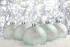 Christmas decorations. Set against a sparkling background Stock Image