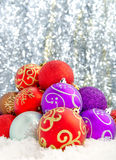 Christmas decorations. Set against a sparkling background Royalty Free Stock Images