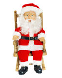 Christmas decorations. Santa Claus in chair figurine, isolated on white royalty free stock images