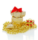 Christmas decorations. Christmas gifts in a brilliant box with decoration, on white royalty free stock images