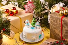 Christmas decorations. With gifts and tasty cake Royalty Free Stock Photo