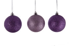 Christmas decorations. Purple christmas decorations baubles isolated on white Stock Image