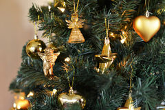 Christmas decorations. Close up of a christmas tree with some golden decorations Stock Photography