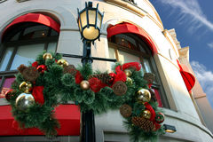 Christmas decorations. On lighting pole and and building Royalty Free Stock Image