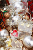 Christmas decorations. Plenty of colorful Christmas decorations, tree adornments and candlesticks Royalty Free Stock Photos