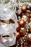 Christmas decorations. Golden and brown Christmas decorations and tree adornments, selective focus Royalty Free Stock Photography