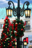 Christmas decorations. On lighting pole and on Christmas tree Stock Image