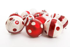 Christmas Decorations. Sitting on a white background.  Focus to foreground balls Royalty Free Stock Photo