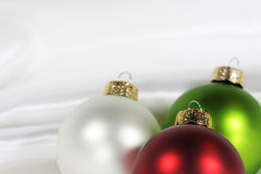 Christmas decorations. On white satin fabric stock photos