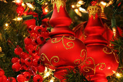 Christmas Decorations. Red ornaments on a Christmas tree Royalty Free Stock Images