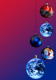 Christmas decorations. A set of Christmas decorations, on graduated blue and red background, with Earth as some of decorations Stock Photos