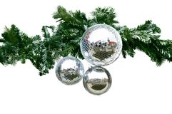 Christmas decorations. Pine boughs with snow and mirrored balls Stock Photos