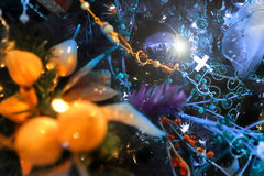 Christmas decorations. With yellow lights and blue background Stock Photography