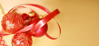 Christmas Decorations. Frame from christmas ornaments. Isolation on gold Royalty Free Stock Photo