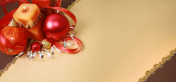 Christmas Decorations. Christmas postcard -  red balls, candle, paper streamer, the tape Stock Photos
