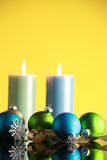Christmas decorations. On yellow background,focus on blue ball and gold ribbon Stock Images