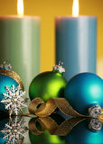 Christmas decorations. On yellow background,focus on blue ball and gold ribbon Stock Image