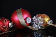 Christmas decorations. On black reflective background Stock Photography
