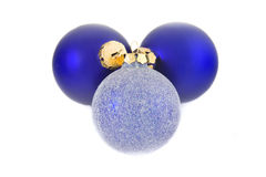 Christmas decorations. Three Christmas baubles on a white background Royalty Free Stock Photos
