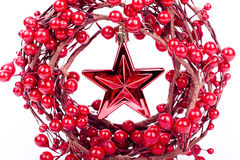 Christmas decorations. Red Christmas decorations star and berries on white background Stock Images
