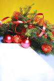 Christmas Decorations. Frame from Christmas ornaments. Isolation on yellow Stock Image