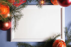 Christmas Decorations. White frame from Christmas ornaments. Isolation on blue Stock Photo