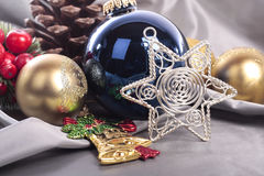 Christmas decorations. On silver fabric Royalty Free Stock Images