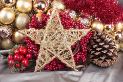 Christmas decorations. Closeup with gold star Royalty Free Stock Photography