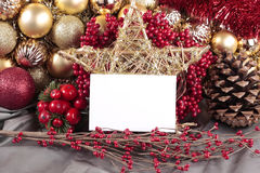 Christmas decorations. With blank card on silver background Stock Photo