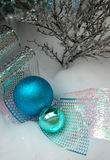 Christmas Decorations. Photo of the blue Christmas decorations and ribbon on white background Stock Photo