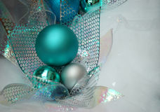 Christmas Decorations. Photo of the blue Christmas decorations and ribbon on white background Stock Photos