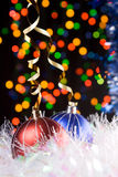 Christmas decorations. Christmas baubles and defocused lights background Royalty Free Stock Photo